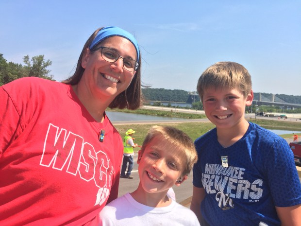 Amie Schroeder woke her two young sons, George, 11, and Jackson,8, early on Wednesday morning so they could take part in a historic event: the opening of the new St. Croix River bridge. (Mary Divine / Pioneer Press)