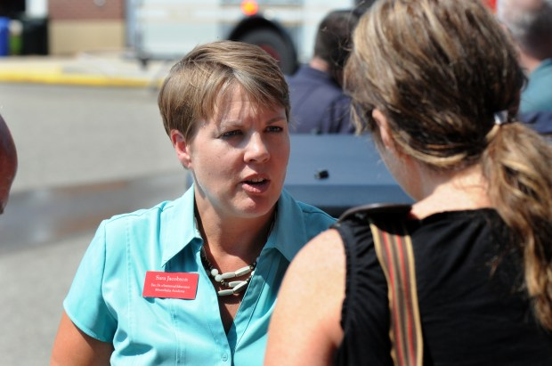 Sara Jacobson, executive director of institutional enhancement at Minnehaha Academy, talks to a neighbor about the situation at Minnehaha Academy in Minneapolis Wednesday, Aug. 2, 2017. (Dave Orrick / Pioneer Press)