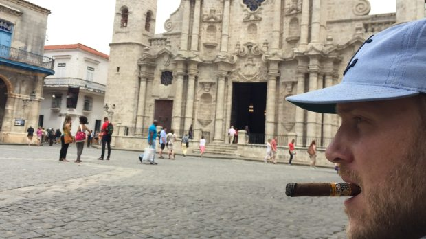 The author smokes a famous Cohiba cigar on front of Catedral de San Cristobal de la Habana in the old Havana district in April 2017. (Courtesy of Jackie Gaston)