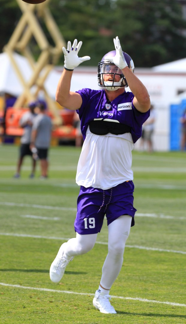 Minnesota Vikings wide receiver Adam Thielen (19) makes a catch during NFL football training camp Thursday, July 27, 2017, in Mankato, Minn. (AP Photo/Andy Clayton-King)