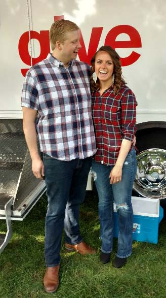 "Josh Elfstrum and Denise Konder are photographed outside the Red Cross bloodmobile at the Minnesota State Fair in Falcon Heights on Thursday, Aug. 24, 2017. The couple first went to the Fair together as friends in 2014. Deciding on a whim to give blood together that day, they were told by a volunteer: ""The couple that gives blood together, stays together."" They returned to the Fair this year on opening day to have their engagement photos taken. (Courtesy of Denise Konder)"