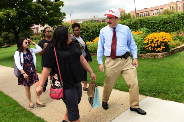 Mark Gordon, Dean of the Mitchell Hamline School of Law takes some of his students out for ice cream on Grand Avenue in St. Paul,  August 10, 2017. From left: students Nou Her, Aaron Robinson, Kimberly Hanes and Ava Cavaco (Scott Takushi / Pioneer Press)