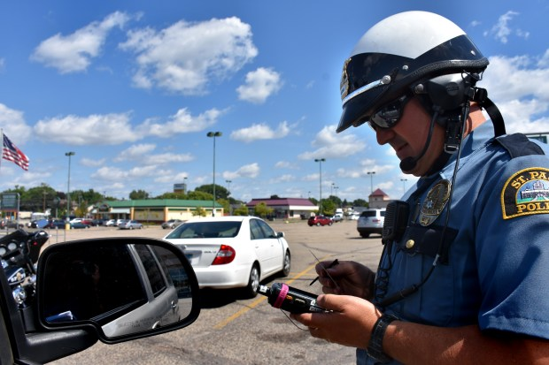 After other officers spotted a man who appeared to be texting and driving, St. Paul Police Officer Matt Arntzen pulled the driver over in the Midway Shopping Center on Wednesday, Aug. 23, 2017. He cited him for texting and driving. (Mara H. Gottfried / Pioneer Press)