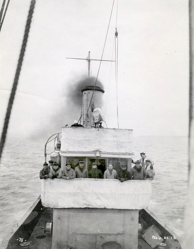 The crew of a French minesweeper -- possibly the Cerisoles, Inkerman or Sebastopol -- is seen aboard the ship during a trial on Lake Superior offshore from Fort William, Ontario, on Nov. 21, 1918, two days before those three ships left for Europe. (City of Thunder Bay Archives Accession #1991-1-360-76)