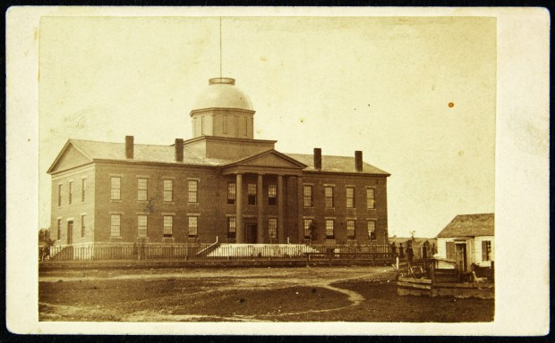 Minnesota's first State Capitol, pictured here about 1865, was at 10th and Wabasha streets in downtown St. Paul. Although this initial design was gracefully simple, it was modified considerably over the next 15 years until it was virtually unrecognizable. (Courtesy of the Minnesota Historical Society)