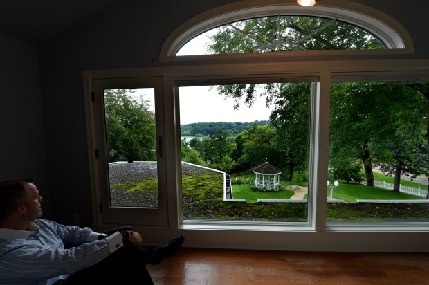 The sunroom directly attached to the master bedroom in the bridal suite overlooks the St. Croix River Valley at 210 Laurel in Stillwater on Wednesday, July 16, 2017. The upscale mansion is now available for short-term rentals. (Jean Pieri / Pioneer Press)