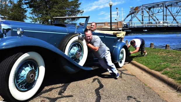 """Something can always go wrong with older cars,"" said Mark Desch, center, a Stillwater business owner and classic-car collector, as his employees, John Seckinger, left, and Mike Kohanek push his 1931 Stutz convertible after the starter quit during a photo shoot near the Stillwater Lift Bridge on Friday, July 28, 2017. They were able to push-start the car. Stillwater Mayor Ted Kozlowski has asked Desch to be the last driver to cross the lift bridge when it closes to car traffic on the evening of Aug. 2. The bridge opened in 1931. (Jean Pieri / Pioneer Press)"