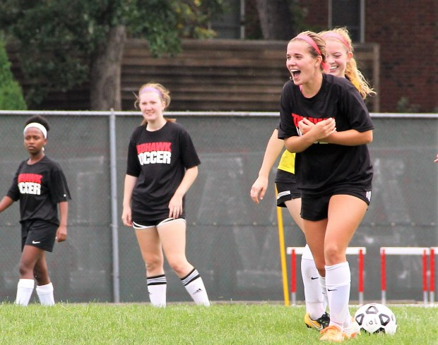Minnehaha Academy senior midfielder Lily Mullinix laughs during the first day of practice on Monday, Aug. 14 at Minnehaha Academy's Lower School in Minneapolis. (Jace Frederick / Pioneer Press)