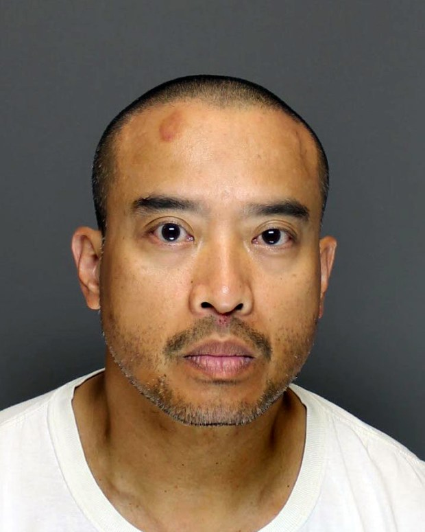 Aug. 1, 2017 courtesy photo of Lucifer Vincent Nguyen. Nguyen, 44, was arrested late Monday July 31, 2017 in Blaine after a three-day manhunt. Nguyen is charged in the fatal shooting of Beverly Cory, 48, of Maplewood, while fleeing authorities following a robbery Saturday July 29 in Mendota Heights. (Courtesy of the Dakota County Sheriff's Office)