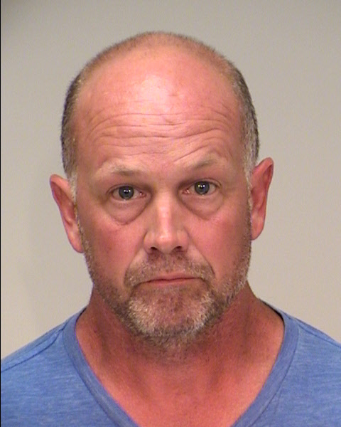 Michael William Searles, 49, faces one count of felony level theft by swindle in Ramsey County District Court. The former athletic director of Como Senior High School in St. Paul is accused of stealing public funds from his employer during his six-year career with the school. (Courtesy Ramsey County Jail)