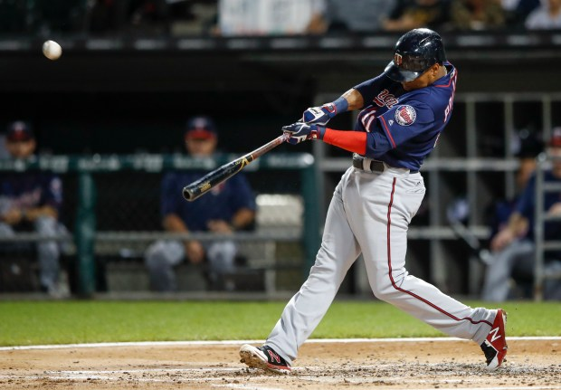 Minnesota Twins' Jorge Polanco hits three-run home-run off Chicago White Sox' Carson Fulmer during the second inning of game two of a baseball doubleheader, Monday, Aug. 21, 2017, in Chicago. (AP Photo/Kamil Krzaczynski)