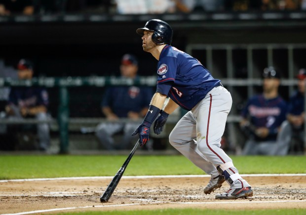 Minnesota Twins' Brian Dozier watches his three-run home-run off Chicago White Sox' Carson Fulmer during the second inning of game two of a baseball doubleheader, Monday, Aug. 21, 2017, in Chicago. (AP Photo/Kamil Krzaczynski)