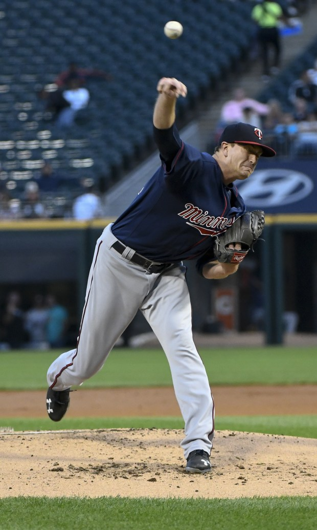 Minnesota Twins starting pitcher Kyle Gibson delivers against the Chicago White Sox during the first inning of a baseball game in Chicago on Tuesday, Aug. 22, 2017. (AP Photo/Matt Marton)