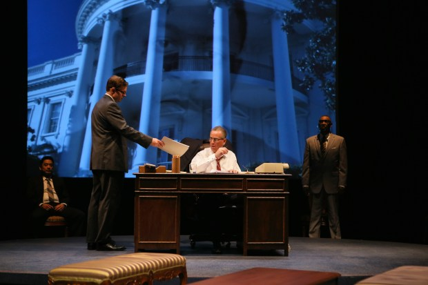 """Song Kim as Governor Sanders, left, Peter Middlecamp as Walter Jenkins, Pearce Bunting as LBJ, and Joe Nathan Thomas as Roy Wilkens in """"All the Way."""" (Photo by Scott Pakudaitis"""