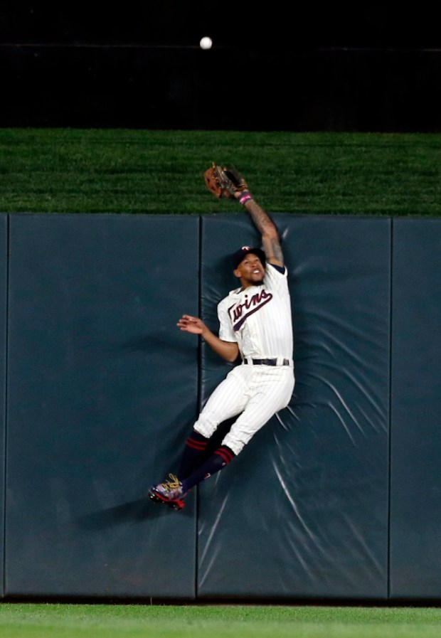 Minnesota Twins center fielder Byron Buxton makes a futile attempt for the ball as Toronto Blue Jays' Josh Donaldson hits a solo home run over him in the ninth inning of a baseball game Saturday, Sept. 16, 2017, in Minneapolis. (AP Photo/Jim Mone)