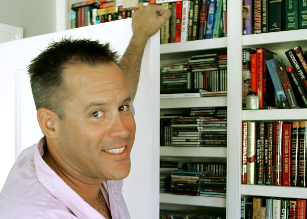 "This Sept. 2, 2005 file photo shows best-selling author Vince Flynn in the library of his Edina, Minn. home. The late Minnesota author's counterterrorism operative Mitch Rapp is coming to the big screen in ""American Assassin."" Flynn, who wrote a series of thrillers featuring Rapp, died in 2013 after battling prostate cancer. (AP Photo/Jim Mone, File)"