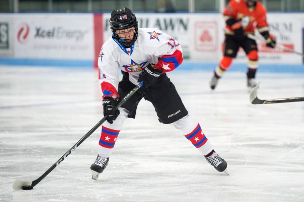 Cruz Lucius, 13, and his 14-year-old brother Chaz committed to play hockey for the Gophers last month, becoming the youngest players to commit to the men's hockey program. They are part of a growing trend in college hockey of teams recruiting younger athletes. Cruz, shown above, and his brother play hockey for Gentry Academy in Vadnais Heights. (Courtesy/Gentry Academy)