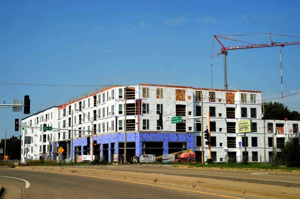Construction continues in Shoreview on a 148-unit mixed-use project on Rice Street, just north of Interstate 694, on Wednesday, Aug. 30, 2017. (Scott Takushi / Pioneer Press)