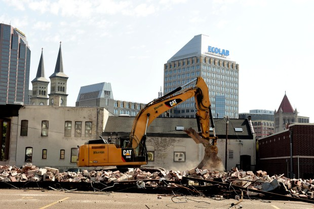 Heavy machinery demolishes Catholic Charities' Dorothy Day Center in St. Paul on Wednesday, Sept. 13, 2017. Demolition of the homeless shelter began Wednesday in order to make way for a much bigger center, which is set for completion in July 2019. (Scott Takushi / Pioneer Press)