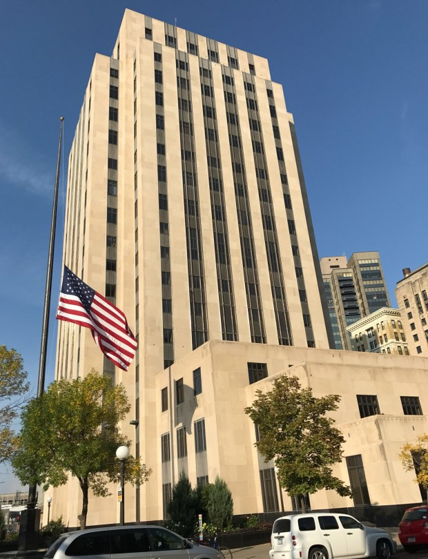 A U.S. flag flies at half-staff at the Ramsey County Courthouse and St. Paul City Hall on Sept. 14, 2017, in honor of Wayzata Police officer William Mathews, who was struck and killed by a car while on duty Sept. 8. (Jaime DeLage / Pioneer Press)