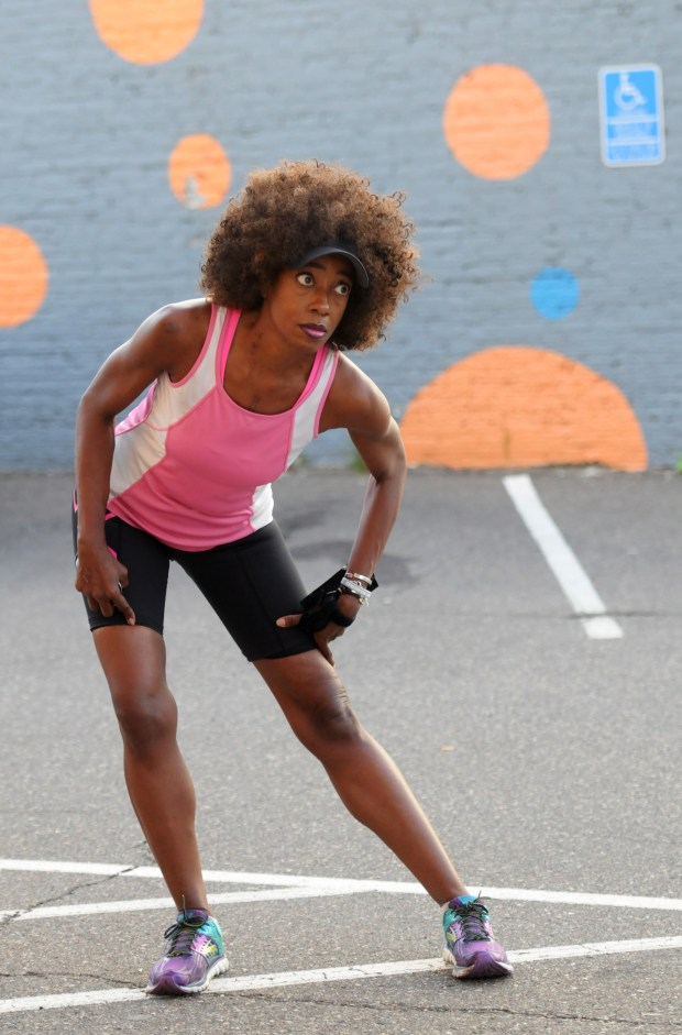 Yasmin Mulling stretches in the parking lot of the Running Room on St. Paul's Grand Ave. before a training run on Thursday, Sept. 21, 2017. Mullings, a Ramsey County prosecutor, lost consciousness in a courtroom last year while grilling a key defendant in a complex, high profile sex-trafficking case. A month later she learned that a rare infection in her heart had caused the organ to fail and she had a heart transplant. Mullings ran a 10-mile race during Medtronic's Twin Cities marathon weekend on Oct. 1. (Ginger Pinson / Pioneer Press)