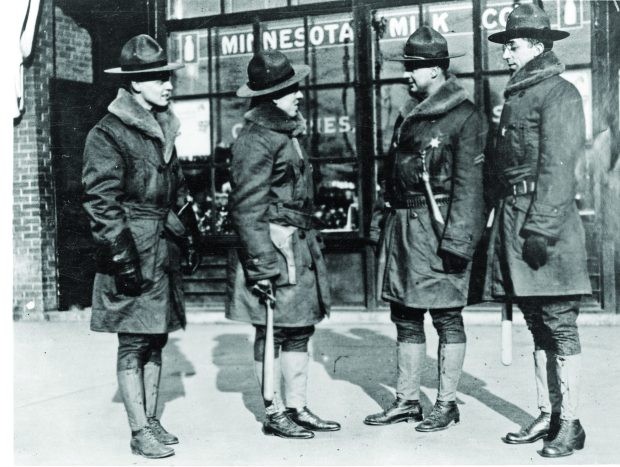 Members of the Minnesota Home Guard patrol on University Avenue in December 1917. Courtesy of the Minnesota Historical Society)