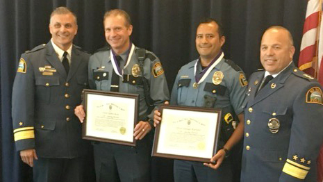 St. Paul Police Deputy Chief Paul Iovino, Officer Jeff Boyle, Officer Santiago Rodriguez and Police Chief Todd Axtell, left to right, pose for a photo after the two officers received the department's Life-saving Award on Wednesday, Sept. 20, 2017. They administered CPR to a man who overdosed on heroin, saving his life. (Courtesy of St. Paul Police Department)