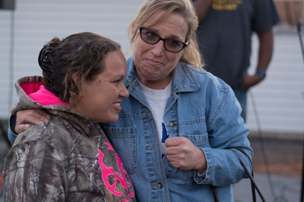 Sarah Block, left, gets a squeeze from Dawn Erickson after Block spoke Friday about her daughter's heroic actionson Friday, Sept. 8, 2017. The 15-year-old Jasmine who thought she was helping a friend's father was instead kidnapped and held captive for 29 days during which she was assaulted and restrained with zip ties before escaping and swimming across a lake to safety, prosecutors said. Three men are charged in the incident. (Beth Leipholtz | Forum News Service)