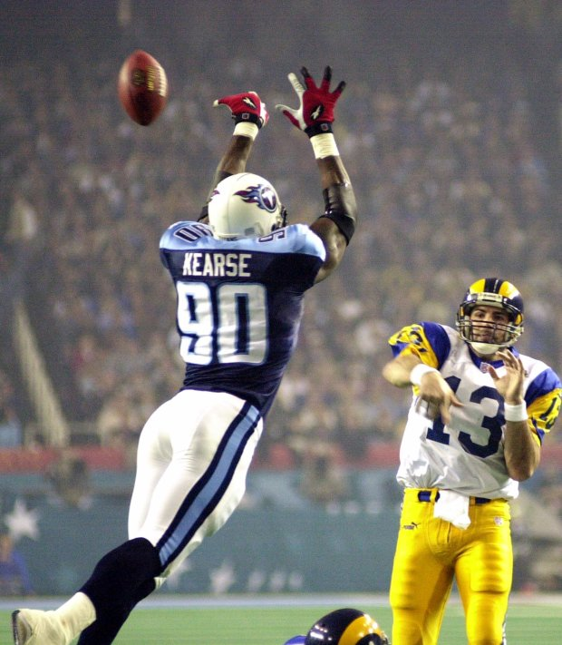 St. Louis Rams quarterback Kurt Warner (13) attempts a pass as Tennessee Titans defensive end Jevon Kearse (90) attempts to block it in the third quarter during Super Bowl XXXIV in Atlanta, Sunday Jan. 30, 2000. (AP Photo Dave Martin)