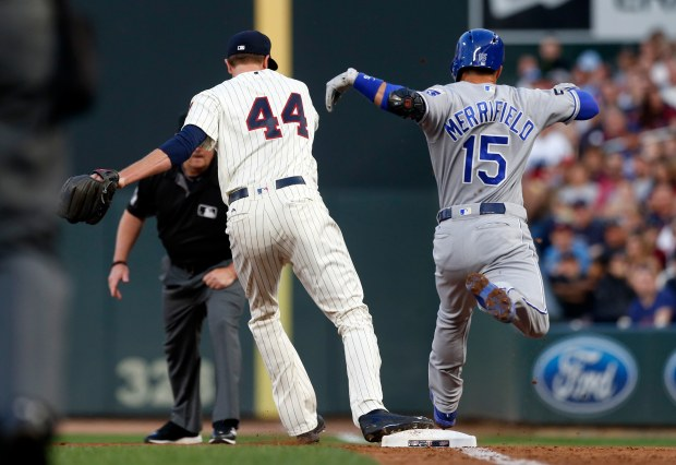 Minnesota Twins pitcher Kyle Gibson, left, beats Kansas City Royals' Whit Merrifield to the bag for the out after Merrifield grounded to first baseman Joe Mauer in the third inning of a baseball game Saturday, Sept, 2, 2017, in Minneapolis. (AP Photo/Jim Mone)