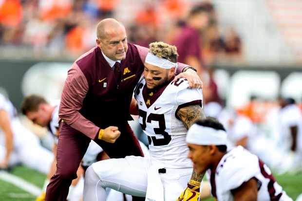 Minnesota head football coach P.J. Fleck talks with Gophers running back Shannon Brooks (23) before a preseason game against Oregon State in Corvallis, Ore. on Saturday, Sept. 9, 2017. (Ben Blair/Special to the Pioneer Press)