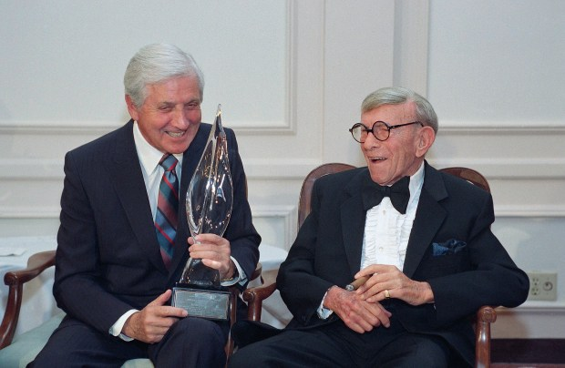 "In this March 14, 1993, file photo, Monty Hall, left, recipient of the 2nd Annual George Burns Lifetime Award, laughs with George Burns at the United Jewish Fund tribute to humanitarian Hall, in the Century City section of Los Angeles. Former ""Let's Make a Deal"" host Hall has died after a long illness at age 96. His daughter Sharon Hall says he died Saturday, Sept. 30, 2017, at his home in Beverly Hills, Calif. (AP Photo/Julie Markes, File)"