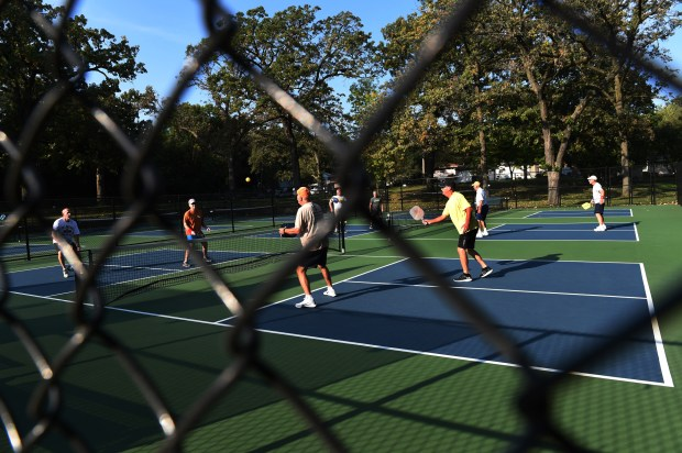 Members of the Woodbury Pickleball Club play pickleball at Shawnee Park in Woodbury on Wednesday, Sept. 13, 2017. Woodbury recently tore out two old tennis courts and replaced them with six pickleball courts. The Woodbury Pickleball Club, with 250 members, plays there from 9 a.m. to 1 p.m. six days a week. (Jean Pieri / Pioneer Press)
