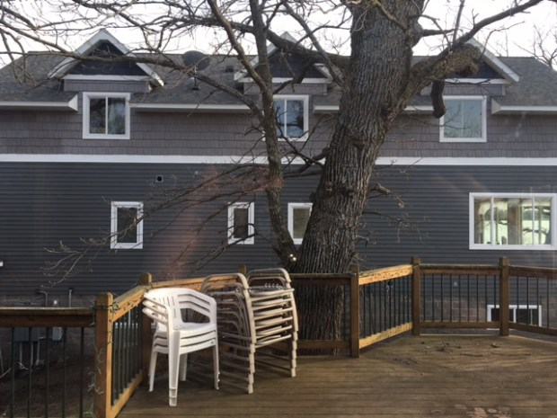 The view from the living room of Thomas and Holly Ruether of the post-renovation home of Kathleen and Matt Mimbach on Grand Lake in Rockville, Minn., has degraded the Ruethers' quality of living, the couple argued in court. (Courtesy Thomas and Holly Ruether)