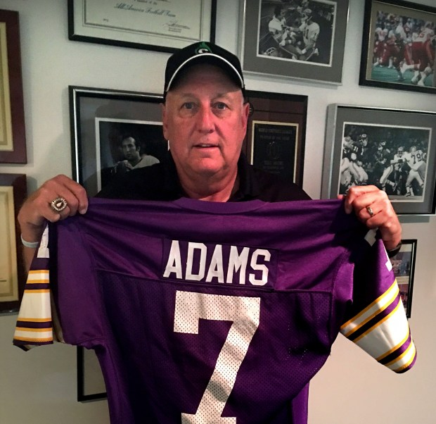 Sept. 2017 courtesy photo of Tony Adams with his original jersey from when he was the starting quarterback for the Minnesota Vikings, who fielded a rag-tag team of replacement players for three games of the 1987 season during a 24-day players strike. When NFL players went on strike on Sept. 22, 1987, Adams was 37, playing in a touch football league in Kansas City and six years removed from his last playing experience with the Toronto Argonauts of the Canadian Football League. Compared to most of the replacement Vikings, Adams had an impressive NFL resume, having spent four seasons as a backup quarterback with the Kansas City Chiefs from 1975-78. Adams also had a couple of strong Minnesota connections, having played under Vikings assistant coaches Bob Schnelker and Paul Wiggin in Kansas City. (Courtesy of Tony Adams)