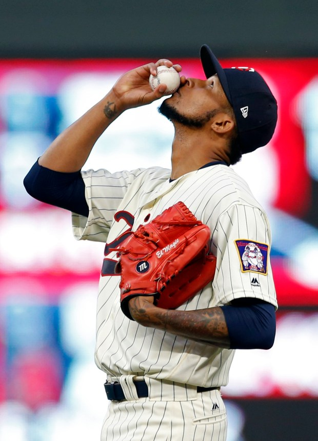 Minnesota Twins pitcher Ervin Santana looks skyward with the ball before throwing against the San Diego Padres in the first inning of a baseball game Wednesday, Sept. 13, 2017, in Minneapolis. (AP Photo/Jim Mone)