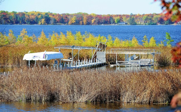 A football field-sized floating bog collided with the Family Fun Lot Owners dock overnight Friday causing damage on southeast shore of North Long Lake's Merrifield Bay. (Steve Kohls / Forum News Service)