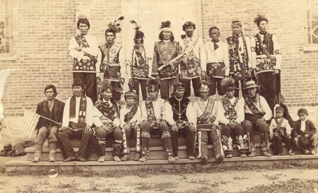 Chippewa Indians at White Earth Reservation in gala attire in 1886 proudly wear their bandolier bags. (Courtesy of Minnesota Historical Society Press)