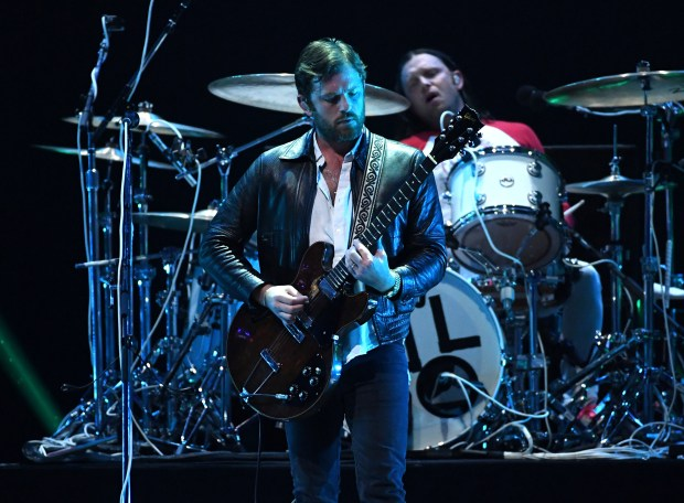 Caleb Followill, left, and Nathan Followill, on drum riser, of Kings Of Leon perform during the 2017 iHeartRadio Music Festival at T-Mobile Arena on Sept. 23 in Las Vegas, Nevada. (Photo by Kevin Winter/Getty Images for iHeartMedia)