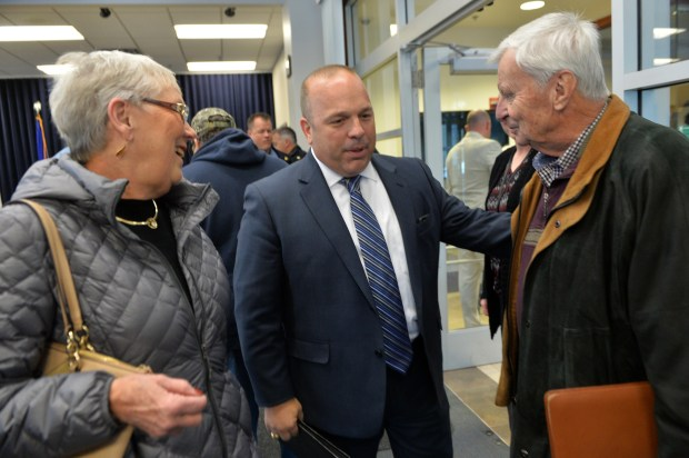 St Paul Police Chief Todd Axtell, center, speaks with Linda and Jim Lee, as the Allan G. Lee memorial stone, previously located on Marshall Avenue, was moved to and dedicated in front of the Western District Police Headquarters in St. Paul on Hamline Avenue, Oct. 30, 2017. St. Paul Police Detective Allan G. Lee was shot and killed by a robbery suspect in 1949. Jim Lee is Allan Lee's son, and Linda is Jim's wife. (Scott Takushi / Pioneer Press)