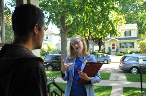 St. Paul mayoral candidate Elizabeth Dickinson stops at the home of Chris Bradley in St. Paul on Saturday, Sept. 30, 2017 as she knocks on doors while campaigning. (Ginger Pinson / Pioneer Press)