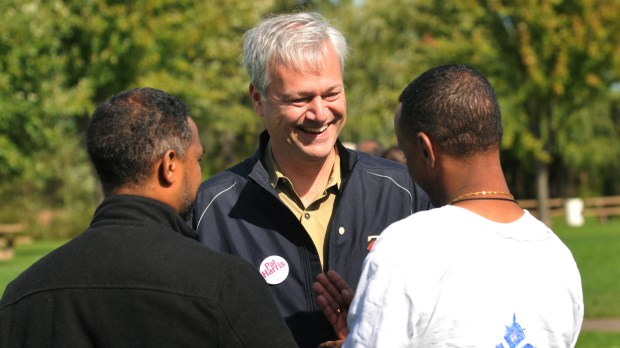 "Pat Harris, a leading candidate for the St. Paul mayoral race, listens to Amanuel Mosazghi, right, of Burnsville, who invited him to attend a ""Finding the True Cross"" event at Phalen Park in St. Paul on Saturday, Sept. 30, 2017. (Ginger Pinson / Pioneer Press)"