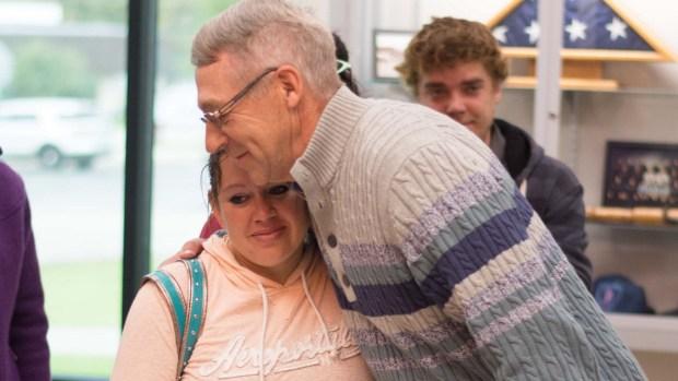 Sarah Block, Jasmine's mother, hugs Earl Melchert as she meets him for the first time since Jasmine's return. (Beth Leipholtz / Echo Press)