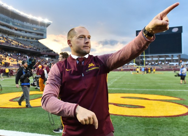 A happy Minnesota head coach P.J. Fleck acknowledges the the fans in the students section after picking up his first Big 10 in a 24-17 victory against Illinois in a NCAA college football game, Saturday, Oct. 21, 2017, in Minneapolis. (AP Photo/John Autey)