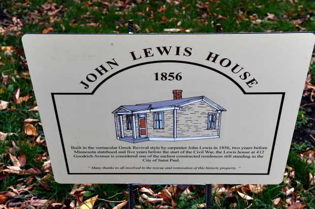 The house at 412 Goodrich Avenue in St. Paul, built by John Lewis in 1856, has this sign in the front yard Thursday, Oct. 26, 2017. (Jean Pieri / Pioneer Press)