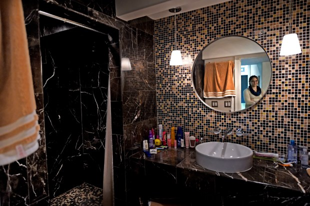 "Estelle Smith shows the huge bathroom in the full basement she rents out in her Minneapolis home on Friday, Oct. 20, 2017. ""I call it my Hugh Hefner bathroom,"" she said. Smith, a University of Minnesota Ph.D. computer science student, is a local Airbnb host who leases her full basement -- including living space, bedroom and huge new shower -- to a student. (Jean Pieri / Pioneer Press)"