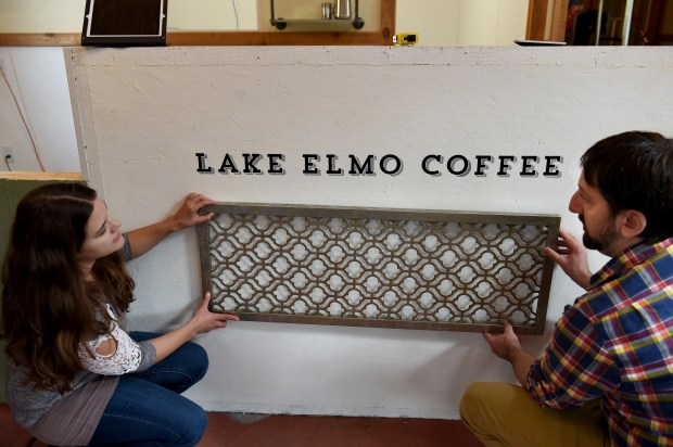 Sarah and Paul Marshall try to figure out decor for the barrista station at Lake Elmo Coffee on Thursday, Oct. 12, 2017. The city has spent millions to attract new businesses to the historic downtown area, and this coffee shop is the first retail business, and a sign that the strategy is working. (Jean Pieri / Pioneer Press)