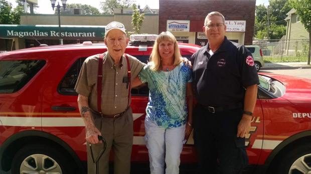 St. Paul Fire Chief Tim Butler, right, with friend Mary Kaase and Walter Holm, a World War II veteran whose brother was a St. Paul firefighter who died in the line of duty in 1945. (Courtesy of Mary Kaase)