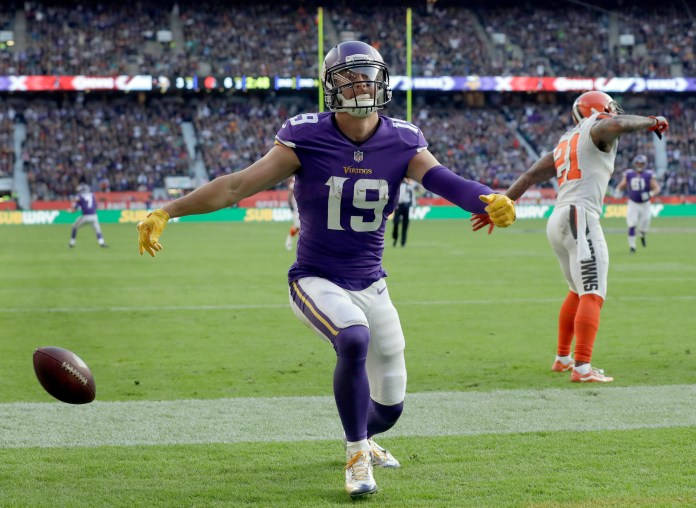 Minnesota Vikings wide receiver Adam Thielen (19) celebrates after catching an 18-yard touchdown pass in the first half of an NFL football game against Cleveland Browns at Twickenham Stadium in London, Sunday Oct. 29, 2017. (AP Photo/Matt Dunham)