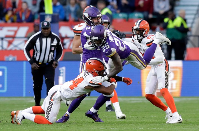 Minnesota Vikings running back Latavius Murray (25) is tackled by Cleveland Browns defensive back Ibraheim Campbell, left, during the first half of an NFL football game at Twickenham Stadium in London, Sunday Oct. 29, 2017. (AP Photo/Matt Dunham)